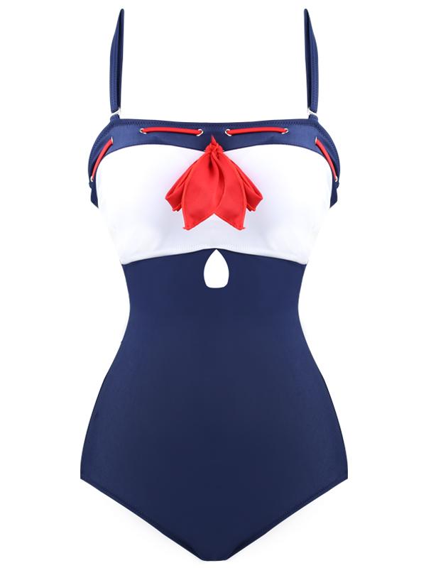 4bd122ed3a Maillot de bain bleu et blanc avec noeux rouge marin pinup retro. Cliquer  pour agrandir